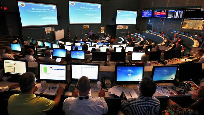 Participants from dozens of county agencies begin a statewide hurricane exercise at the Palm Beach County Emergency Operations Center in West Palm Beach in 2013.