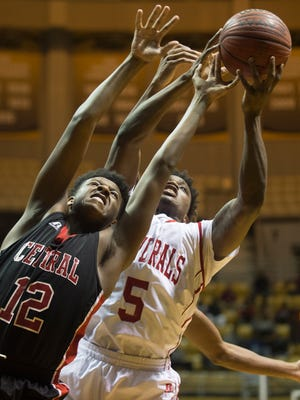 Lee-Montgomery's Quinterrius Rivers (5) fights for a rebound with Central-Phenix City's Donald Jackson during the AHSAA Central Regional Championship game at the Dunn-Oliver Academe in Montgomery, Ala., on Thursday, Feb. 25, 2016.