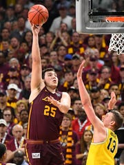 Mar 31, 2018; San Antonio, TX, USA; Loyola Ramblers center Cameron Krutwig (25) shoots the ball over Michigan Wolverines forward Moritz Wagner (13) during the first half in the semifinals of the 2018 men's Final Four at Alamodome.