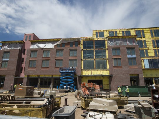 Construction continues on The Elizabeth Hotel in Old Town. The hotel is set to open in October.