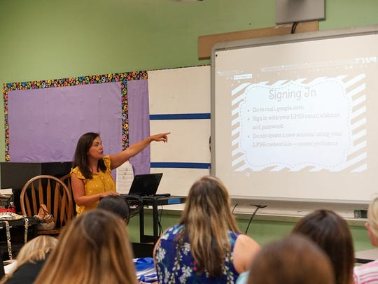 New Lafayette Parish teachers watch during an orientation