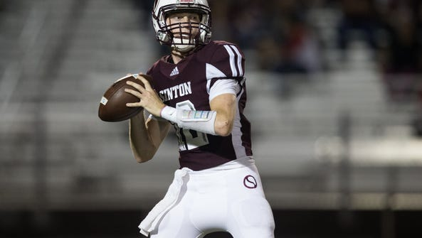 Sinton's quarterback Colt Gorman looks for an open