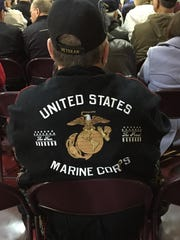 A veterans wears a jacket honoring the U.S. Marine