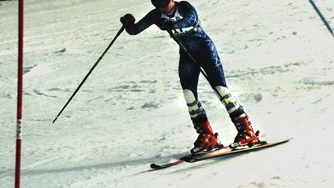 Marquette's Tyler Horton completes his final leg of the slalom race in 1997. Total time was 74.22 for the two runs.