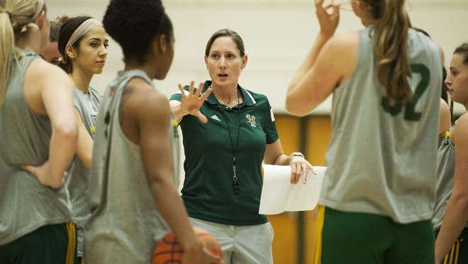 UVM women's basketball coach Lori McBride talks to her team during practice at Patrick Gym last week.