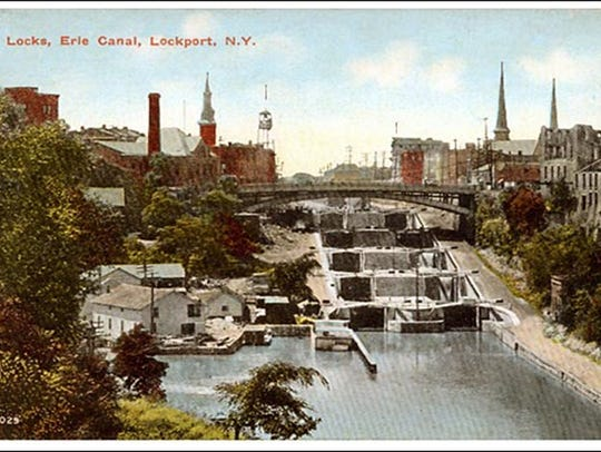 A postcard shows Lockport, NY, and the Erie Canal.