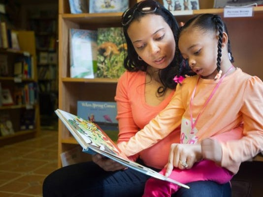 Tiffany Dickerson of Dillsburg reads to her 4-year-old daughter, Sydney, at Midtown Scholar Bookstore in Harrisburg. Dickerson began Sydney s Book Club in August to encourage reading among 3- to 5-year-old kids. The group meets every other week at the bookstore. (DAILY RECORD/SUNDAY NEWS -- PAUL KUEHNEL)
