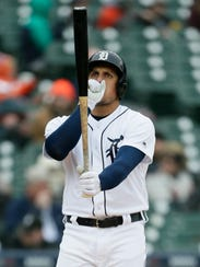 Tigers left fielder Mikie Mahtook warms his hand while
