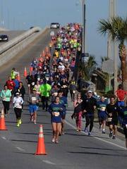 Runners come over the Bob Sikes Bridge Saturday morning during the 2015 Pensacola Double Bridge Run.