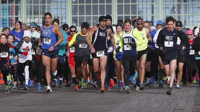 Runners begin the five-mile run from Convention Hall.