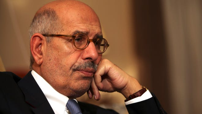 In this Nov. 24, 2012 file photo, leading democracy advocate Mohammed ElBaradei speaks to a handful of journalists including the Associated Press, at his home on the outskirts of Cairo, Egypt.