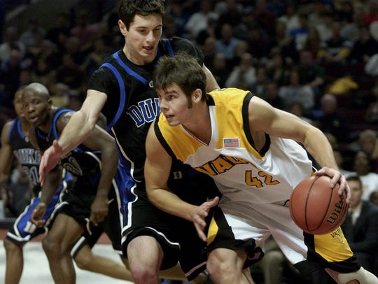 Valparaiso's Dan Oppland drives past Duke's J.J. Redick