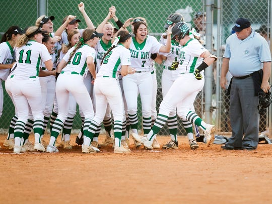 Fort Myers High School softball players celebrate Vivian
