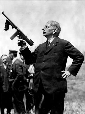 1928: John Taliaferro Thompson is shown holding the weapon he created -- the Tommy Gun. Thompson was from Newport.