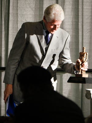 Former President Bill Clinton with the  inaugural Spartan Statesmanship Award for distinguished public service Wednesday, November 18, 2015, which former Michigan Governor James Blanchard presented to him at the Kellogg Center in East Lansing.