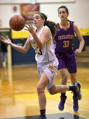 Elco's Emily Bidelspach chases down a loose ball ahead