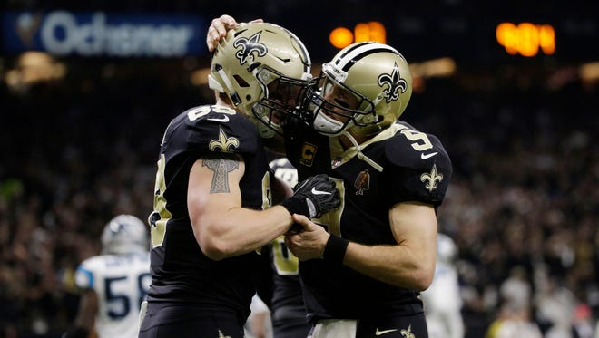 New Orleans Saints tight end Josh Hill (89) is congratulated by quarterback Drew Brees (9) after catching a touchdown pass against the Carolina Panthers during the second quarter in the NFC Wild Card playoff football game at Mercedes-Benz Superdome.