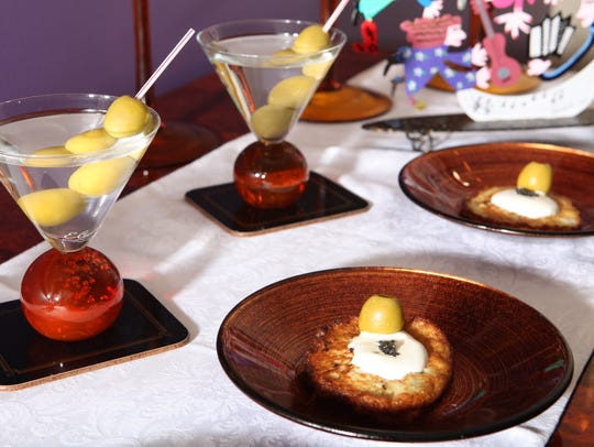 Vespers served with potato latkes garnished with sour cream and caviar.