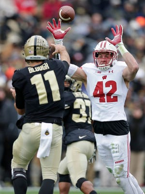 Badgers linebacker T.J. Watt reaches for a pass from Boilermakers quarterback David Blough before intercepting it and returning it for a touchdown during the second quarter of Wisconsin's 49-20 win Saturday over the Purdue Boilermakers at Ross-–Ade Stadium in West Lafayette, Ind.