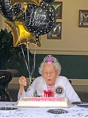 Ruth Snazelle blows out the candles of her birthday cake on May 29, 2020.