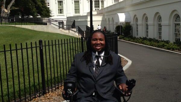 Eric LeGrand had his photo taken at the White House in July 2013 when he visited to help the Christopher Reeve Foundation.
