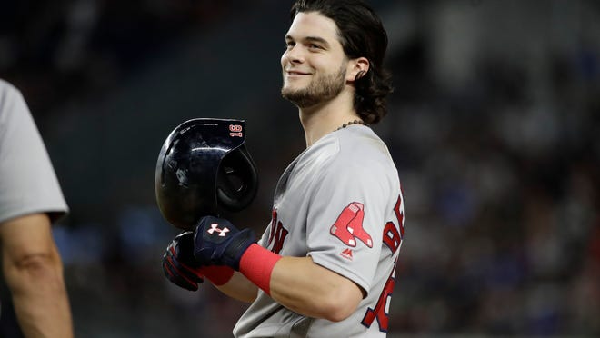 Boston Red Sox's Andrew Benintendi smiles after driving in a run during the 10th inning of the team's baseball game against the New York Yankees on Sunday, Aug. 13, 2017, in New York. (AP Photo/Frank Franklin II)