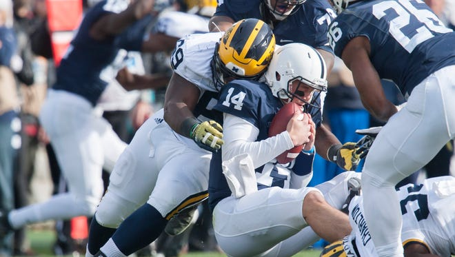 Michigan defensive tackle Willie Henry sacks Penn State quarterback Christian Hackenberg in the second quarter.