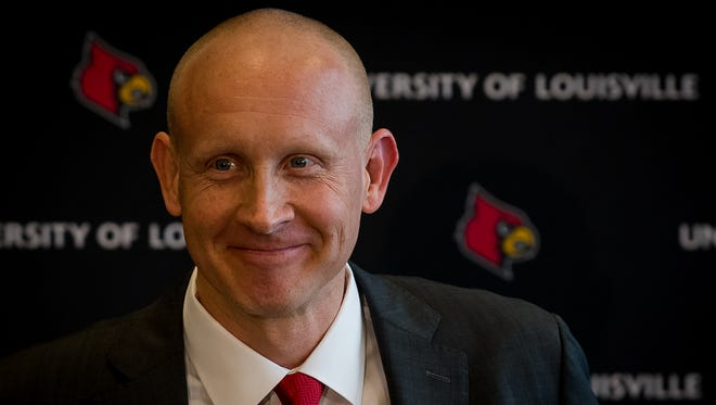 Newly appointed coach of Louisville Cardinals men's basketball team, Chris Mack, speaks at a press conference at the Yum Center in Louisville, Ky, March 28, 2018.