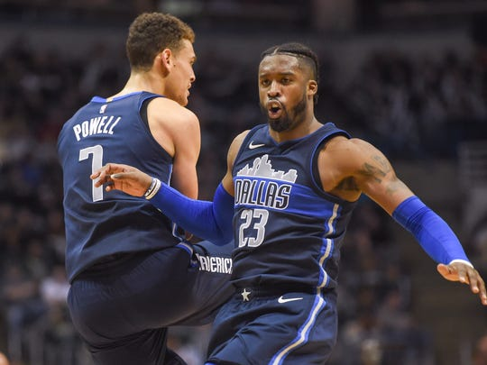 Wesley Matthews (right) celebrates with teammate Dennis Powell against the Bucks.