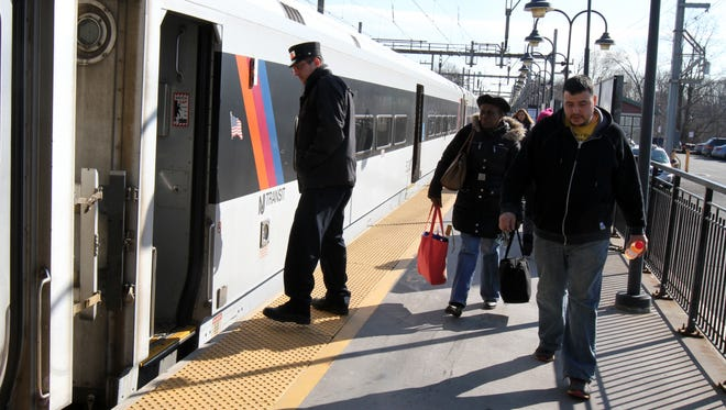 NJ Transit train stops to pick up and drop off passengers at the Aberdeen-Matawan train station in Matawan, NJ Tuesday March 1, 2016.
