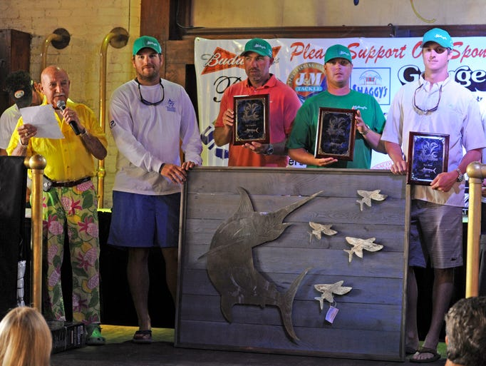 Master of Ceremonies, Ron Thomas, introduces Thomas Cornelison, Justin Hinote, Ryan Long and Brandon Myer who aboard the Friction Course were awarded Pensacola International Billfish Tournament Champions Sunday during the awards ceremony at Seville Quarter.