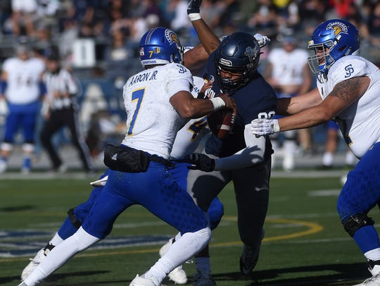Nevada's Malik Reed (90) heads in for a sack against San Jose State quarterback Montel Aaron during their game at Mackay Stadium last year.