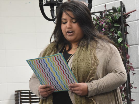 Kayla Flippin Holland reads a letter to the Cotter School Board during a special meeting Thursday, Jan. 14, 2016 in the high school library.