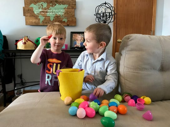 Harrison and Wyatt cracking open their eggs.