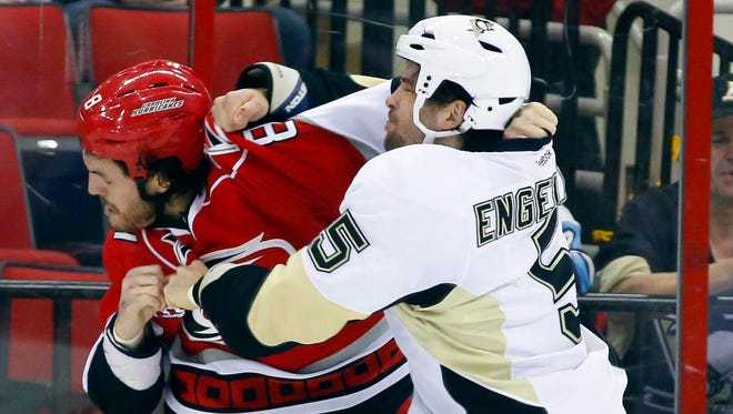 Carolina Hurricanes right wing Kevin Westgarth, left, is known for his physical style.