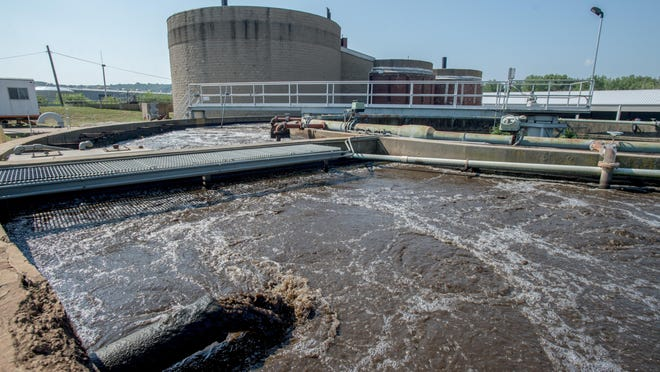 Wastewater swirls in a clarifier Tuesday, July 7, 2020 at East Peoria Sewer Plant #1 on Cass Street in the Richland Farms neighborhood. East Peoria's sewage treatment operation is undergoing a massive, multimillion-dollar overhaul.