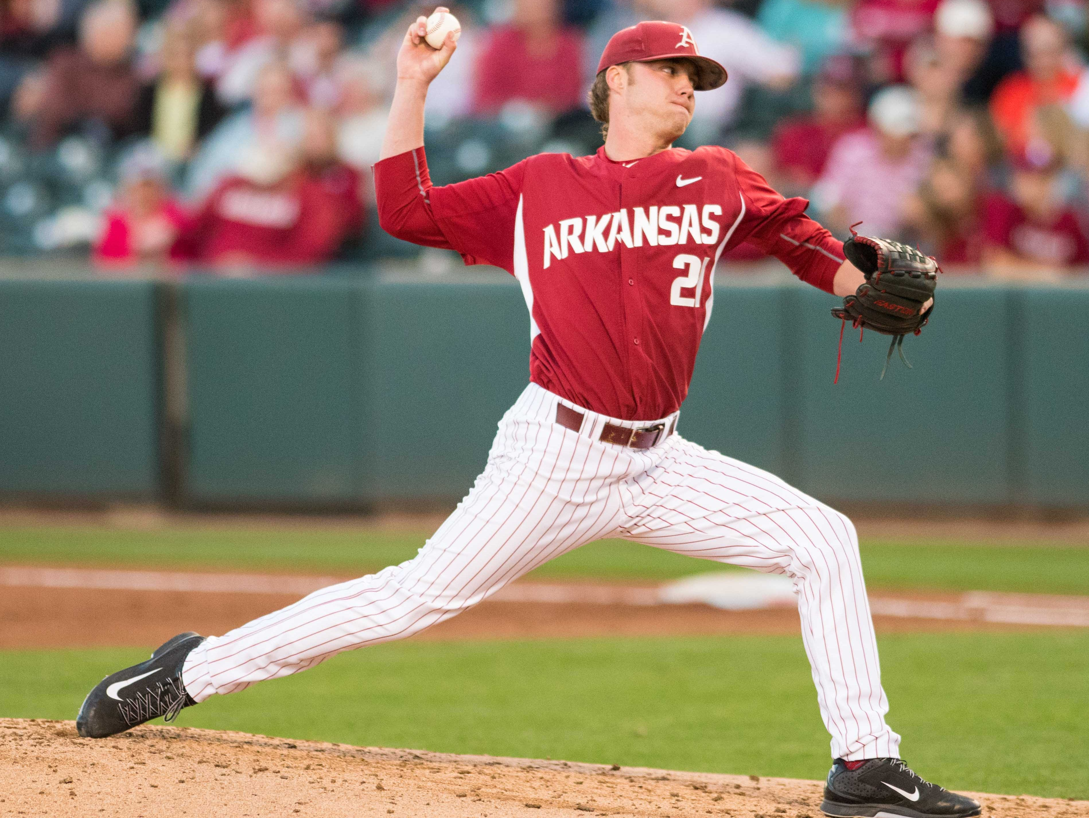 Arkansas starting pitcher Trey Killian delivers a pitch during a recent game at Baum Stadium in Fayetteville.