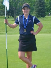 Halle Phillips of Watkins Glen poses with her 2015 Section 4 individual championship medal