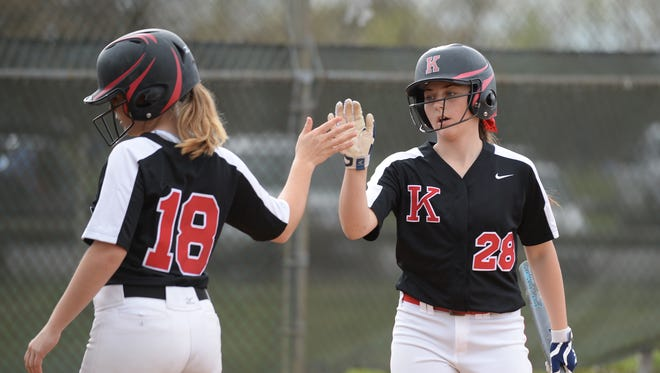 Kingsway's Sarah Cancila, right, high fives Theresa Reed after scoring a run during Wednesday's softball game against Clearview at Clearview High School. 04.25.18.