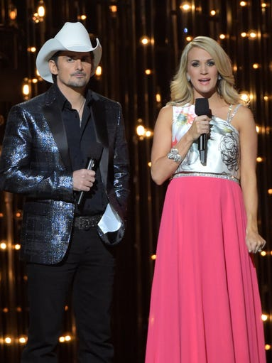 Hosts Brad Paisley and Carried Underwood speak onstage