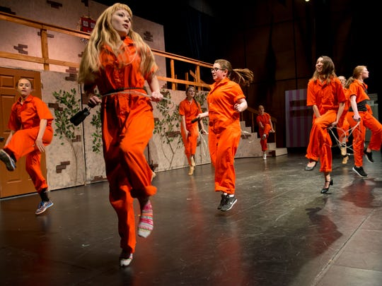"""Prisoners under the direction of accused murderer and workout video star Brooke Wyndham (Kijsa Anderson) perform the exercise-themed song-and-dance number """"Whipped Into Shape"""" in a scene from Gibraltar High School's production of """"Legally Blonde, the Musical."""""""