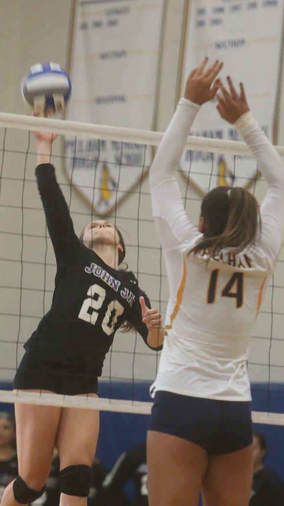 John Jay and Pelham battled in a varsity volleyball