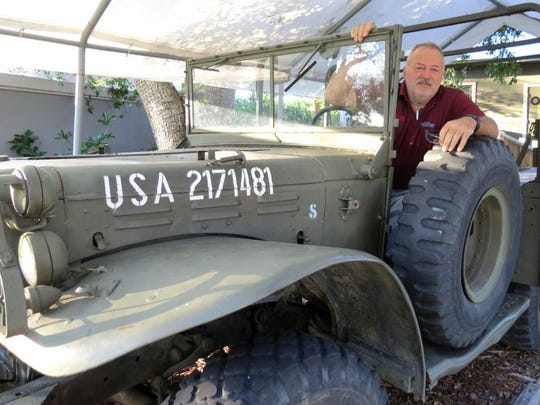 Road to Victory Military Museum founder Michael Roberts sits in a vintage World War II Dodge carrier truck displayed in 2016 in Jensen Beach.