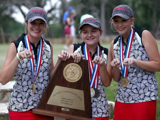 Members of the Sonora High School girls golf team pose with their trophy after winning the Class 3A state title on May 16, 2017.