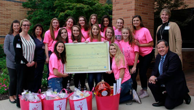 The members of the Hunterdon Central Regional High School Girls Varsity, Junior Varsity and Freshman Volleyball teams presented the Hunterdon Regional Cancer Center with a check for $900.00 on Friday, Oct. 13.