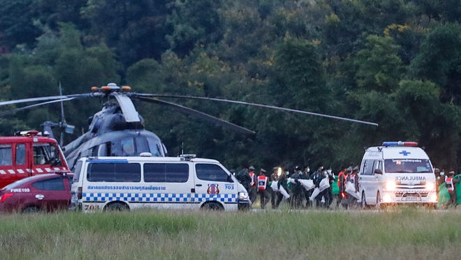 An ambulance believed to be carrying one of the rescued boys from the flooded cave heads to the hospital in Chiang Rai as divers evacuated the remaining boys and their coach trapped at Tham Luang cave in the Mae Sai district of Chiang Rai province, northern Thailand, Tuesday.