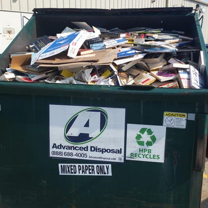 An image shared on Facebook of a dumpster of recycled books