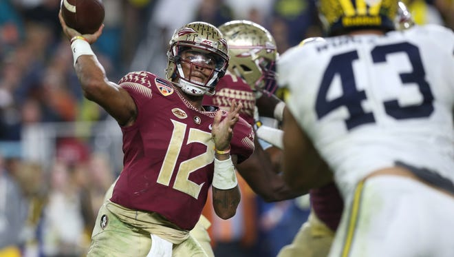 FSU's Deondre Francois throws the ball against  Michigan during the Orange Bowl at the Hard Rock Stadium in Miami Gardens on Friday Dec. 30, 2016.