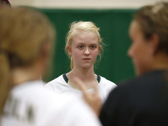 Lincoln High freshman Daelynn Shoaf listens to Trojans volleyball coach Paige Pridgeon during a recent practice. Shoaf has received bimonthly oral immunotherapy treatments in Sarasota since March to manage a deadly peanut allergy.