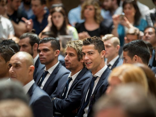 Real Madrid's Cristiano Ronaldo, center right, looks on during a welcome ceremony at Madrid's Regional Government Palace to celebrate the team's victory in La Liga, in Madrid, Spain, Monday, May 22, 2017. (AP Photo/Daniel Ochoa de Olza)
